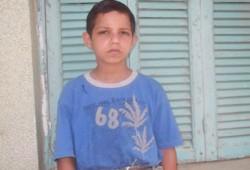 """طفل يطلب التصويت لـ""""د. مرسي"""" لتحسين ظروف أسرته"""