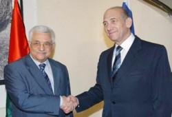 """عباس يعلق العمل بمواد دستورية وأولمرت يعتبر حكومة الطوارئ """"شريكًا""""!!"""