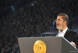 """مد أجل الحكم على الرئيس الشهيد وآخرين بهزلية """"التخابر مع حماس"""" لـ 11 سبتمبر"""