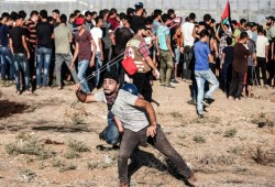 """عشرات الإصابات بعضها بالرصاص الحي في جمعة """"لا للتطبيع"""" بقطاع عزة"""