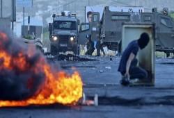 مواجهات واسعة عقب مسيرات حاشدة بالضفة في يوم إضراب فلسطين